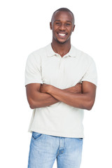 Smiling man posing with arms crossed