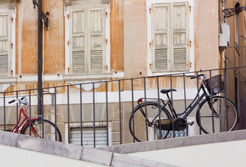Two Bicycles Parked Along a Railing