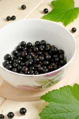 Black currants ripe and natural in a bowl