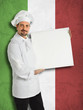 Italian chef showing the menu