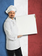 French chef showing the menu