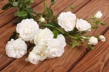 flowers white climbing rose on a wooden table