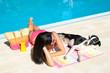 Woman and dog at swimming pool