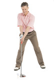 Full Length Of Mature Man Playing Golf