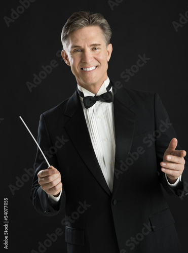 Portrait Of Confident Male Music Conductor Holding His Baton