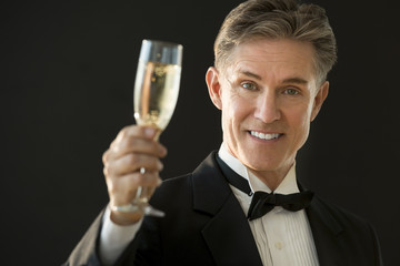 Happy Man In Tuxedo Holding Champagne Flute