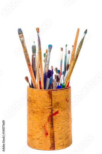Set of paint brushes in pencil holder isolated on white