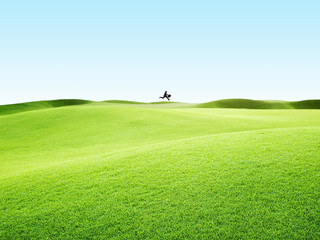 man in grass field jumping