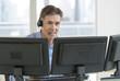 Customer Service Representative Using Multiple Screens