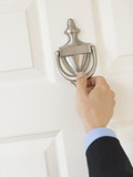 Businessman'S Hand Knocking Door Handle