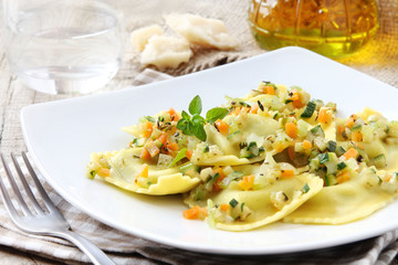 Italian ravioli or tortellini with vegetable sause