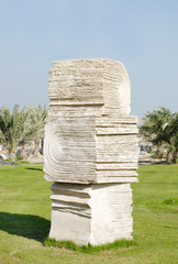 A books sculpture with carved pages at Bahrain