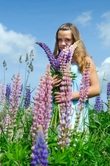 Teenager with lupine flowers