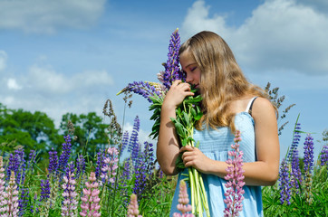 Teenager smelling the flowers