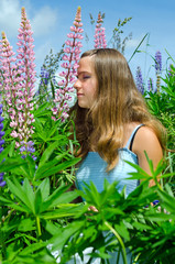 Portrait of beautiful teenager smelling flowers