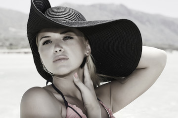 Beautiful blond woman in black hat