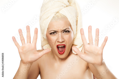 shocked blonde with a towel on her head