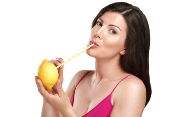 Top up on vitamin c for beautiful young woman drinking juice dir