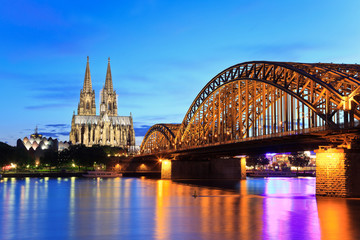 night view of Cologne Cathedral and Hohenzollern Bridge