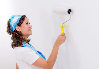 Woman painting the wall