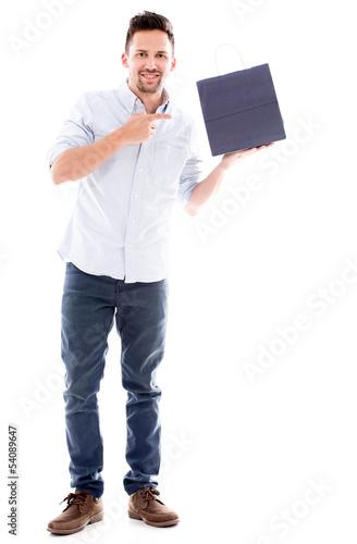 Man pointing at a shopping bag