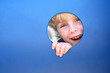 Child Peeking Through Hole at Playground