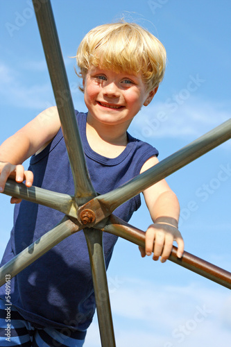 Child Climbing Jungle Gym