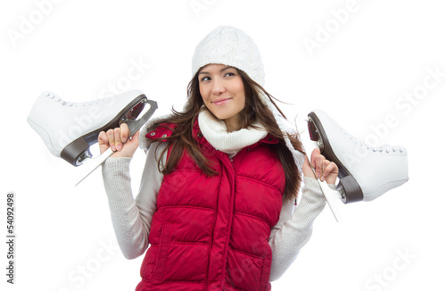 Young woman holding ice skates for winter ice skating sport
