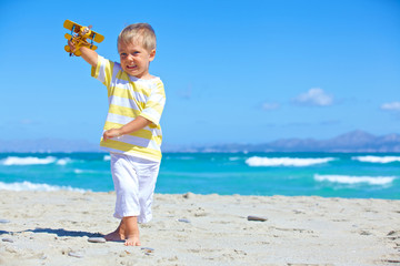 Boy playing with a toy airplane