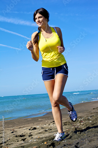 Woman in motion on the beach smiling