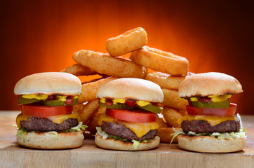 Three Mini Cheeseburger Sliders with Onion Rings
