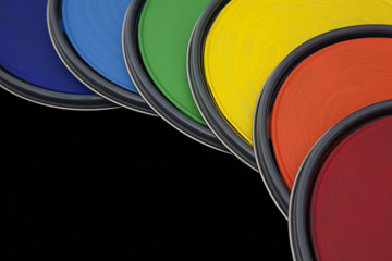 paint can lids with rainbow colored paint