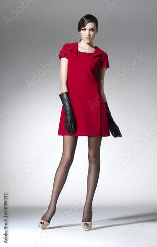 full body fashion woman in red dress with gloves posing