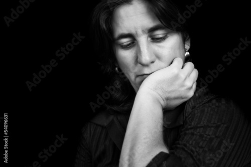 Black and white portrait of a depressed hispanic woman