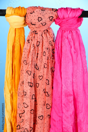 Colored scarves on blue background
