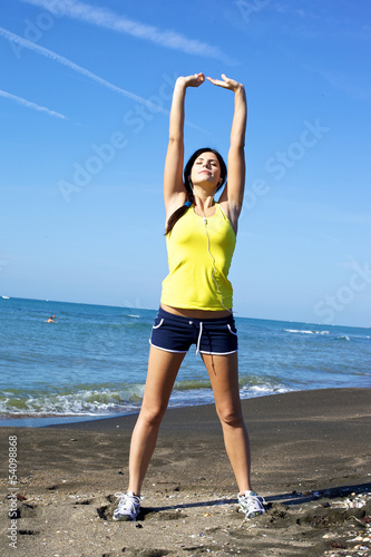 Woman pointing the sky with hands feeling freedom