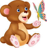 Cute baby bear playing with butterfly