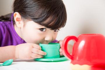 Young Girl Enjoying Her Tea