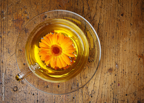 marigold tea on a wooden table