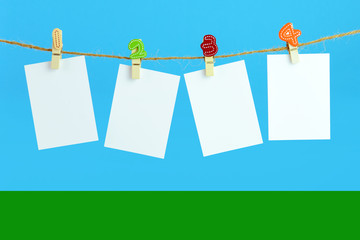 Hanging plain cards on clothesline
