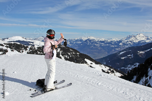 Woman with alpine ski on the piste