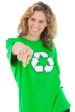 Smiling environmental activist wearing green shirt with recyclin