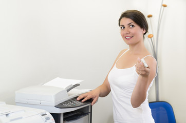 Young business woman making copies