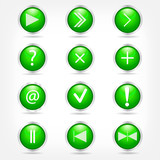 A set of green glass buttons with arrows and math signs.