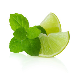 Lime slices and mint lwaves isolated on white bacground