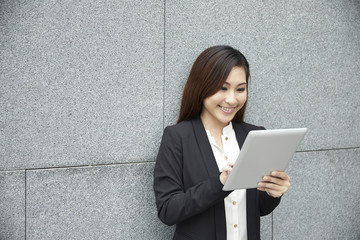 Chinese business woman with a tablet computer.