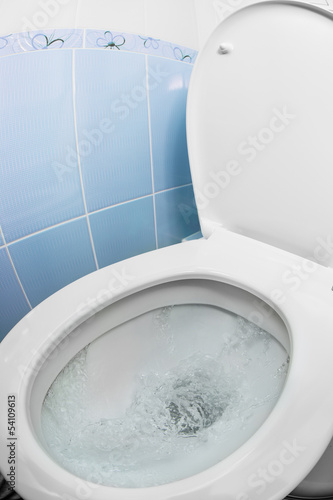 water flushing in toilet bowl or sink or WC