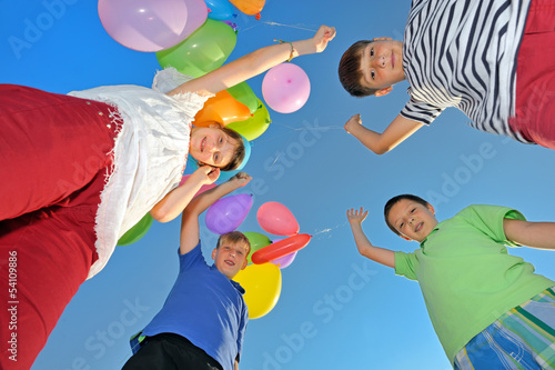 kids play with balloons