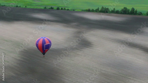 Inside of air balloon pov, smooth motion aerial countryside view