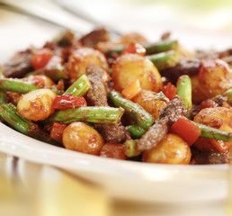 Meat strips with beans pepper potato and  tomato sauce